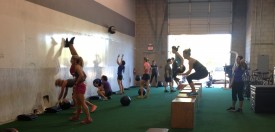 The 8am CrossFit class tackles box jump overs, wall balls and strict HSPUs.