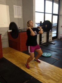 New CrossFitter, Molly, keeps her core engaged thus giving her posture during the barbell complex wod we did on Wednesaday.