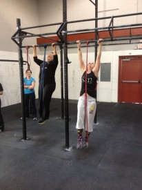 Two of our Basics members practice their banded pull ups during our post class Prep session.