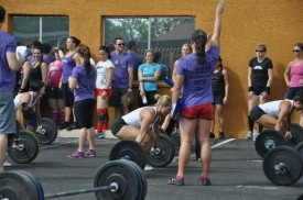 Katie Jo, Aimee and Deana prepare to make their lifts during the Snatch Ladder at the Garage Games in October 2012.