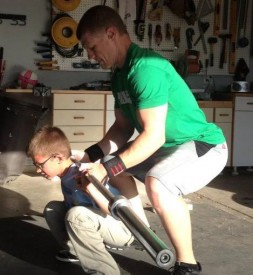 CrossFit Kids coach Josh MacDonald works with his son Caden at home.