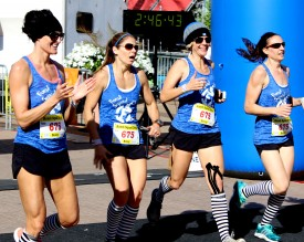 The Bomb Squad divas crossed the finish line together at 3 hours and 16 minutes placing them first overall in the IMS Marathon  Relay.