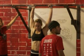 Aimee competed in the 2013 Winter Open back in January, finishing the the thruster/pull up workout with the 3rd fastest time. Notice her good grip on the pull up bar.