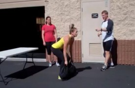 This task based workout starts with 6 sandbag power cleans.  There is a 10 minute cap on this wod.