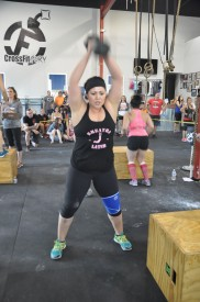 Kristin Coleman takes on event 3-the Box Jump/Dumb bell ladder.  She finished the day 8th overall.