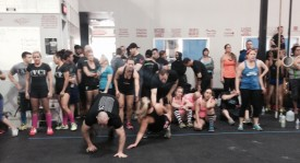 Team Josh take on the first team event which included bear crawls and crab walks between exercises.