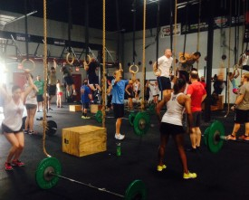 One CrossFit class taking on the Fourth of July WOD which called for heavy power cleans and Muscle ups.  Only a handful of our coaches did this workout RX and under the time cap.